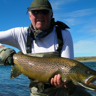 Our team member Chip Drozenski and a 34 inch brown trout from Limay