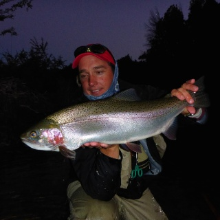 Gonzalo Detry one of our Fishing guides with a nice and big rainbow - Arroyo Verde Lodge