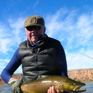 Our team member Chip Drozenski and another brown trout from Limay
