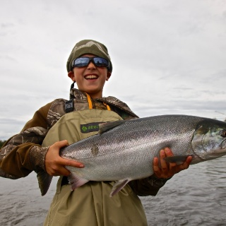 My 10 year old son River with his first silver salmon.....on his second cast ever in Alaska!