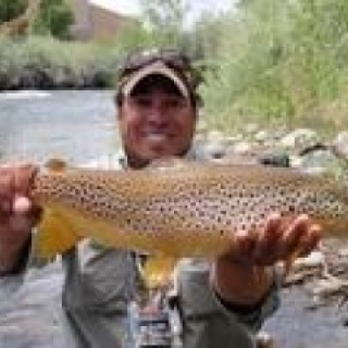 "Cleve F. with a 25"" Nevada Truckee River Brown"