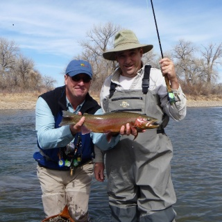 My head guide, Connell O'Grady, with a happy client and beautiful buck rainbow.   It was the clients second time ever fly fishing.