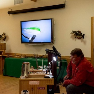 Capt. Gary at the bench teaching students on tying his Lil'hadden fly pattern