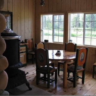 Lodge dining room with pot belly stove,