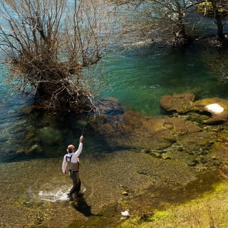 Fly fishing at Tipiliuke lodge by Isaías Miciu