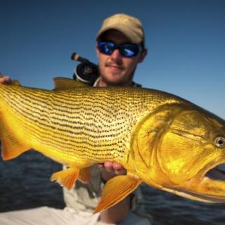 Fergus Kelley Holding a big Golden Dorado - Pira Lodge