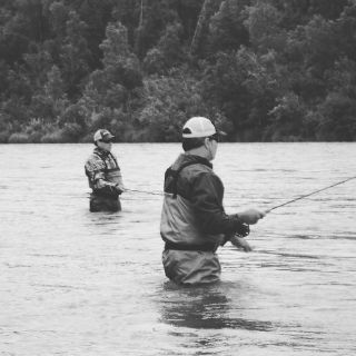 Two brothers fly fishing the Kenai River with Corsetti's Guide Service.