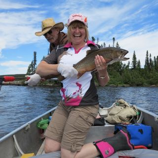 Excited guest about to release a huge brook trout at Igloo Lake Lodge in Labrador