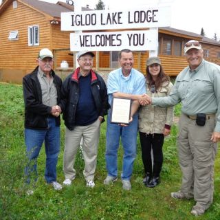 Igloo Lake Lodge (Vince, jim & Amy - 3 generations) receiving an Award from Salmon Association of Newfoundland & Labrador on Catch & Release efforts.