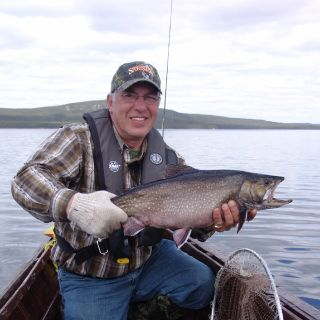 Dwight Blackwood (Newfoundland Sportsman - TV Show) with a huge Labrador Igloo Lake Brook Trout