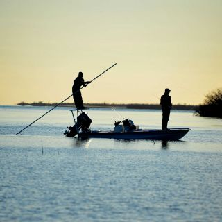 looking for tailing bonefish on the Crooked and Acklins flats. Bahamas