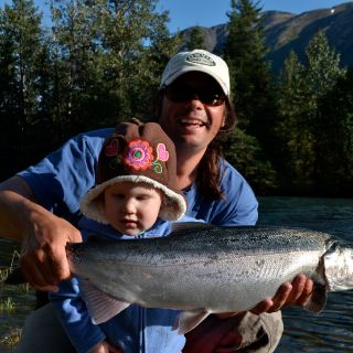 Me and my beautiful daughter with a very bright Coho Salmon caught on the fly on the Kenai River.
