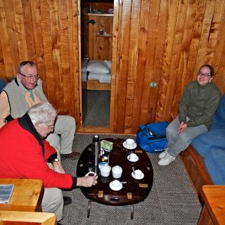 THE SALON ABOARD PUMA II - ANGLING LEGEND CAPT. BILL CURTIS WITH OWNER STEVE SELWAY AND FRAN