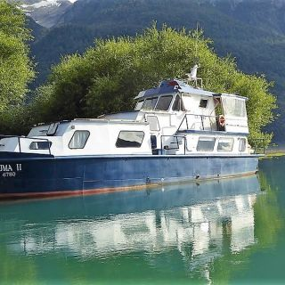 PUMA II AT THE MOUTH OF THE FUTALEUFU  RIVER - THE RELAXING AND EFFICIENT WAY TO FISH THIS FABLED LAKE