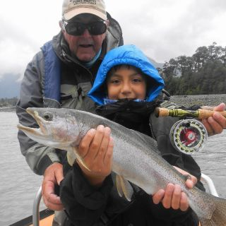 FUTURE GUIDE LEARNING YOUNG. HIS CASTING LESSONS PAYING OFF WITH THIS YELCHO RIVER RAINBOW
