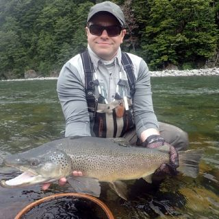 A big Brown trout and happy angler after a skilled presentation to an educated fish all went to plan!
