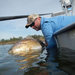 Jason Bryant with a big Louisiana redfish