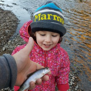My dauther and her first smallest trout