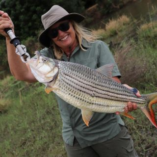 Betsy Robb with a tremendous Tigerfish from the Lower Zambezi