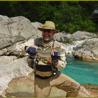 Emerald river and the Alps - where else would you prefer to land your trout!?