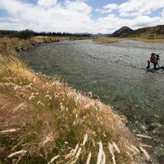 Client Tim (WA OZ)  Battling the wind whilst fishing to the biggest fish he had ever laid eyes on. Yep, after about an hour he caught it. It's the fish in the next pic. South Island  New Zealand Guide: Chris Reygaert