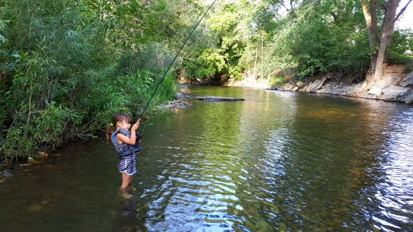 My little 4 year old girl doing it right in the back yard river.